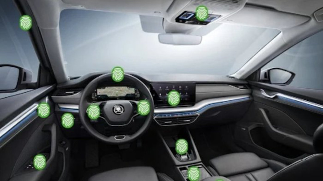 A car interior with digitally added fingerprints around it