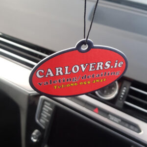 Car Lovers air freshener hanging in a car